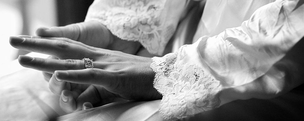 bride wearing engagement ring
